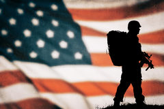 American soldier silhouette. American soldier black silhouette with american flag Royalty Free Stock Images