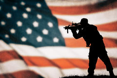 American soldier silhouette. American soldier black silhouette with american flag Stock Image