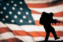 American soldier silhouette. American soldier black silhouette with american flag Stock Photos
