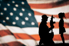 American soldier silhouette. On the american flag Royalty Free Stock Image