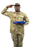 American soldier, soldier, commando, sergeant, militant, serviceman, professional, military, militar. Portrait of soldier holding an american flag and saluting royalty free stock photos