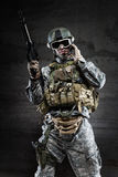 American Soldier talking via radio. American Soldier wearing a mask and talking via radio royalty free stock photos
