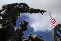 American soldiers statue. Statue of soldiers with the american flag in background stock images