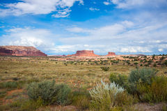 American Southwest Canyon Desert Landscape. Desert landscape with sagebrush in foreground and red sandstone geologic formations in background. Near Moab, Utah Stock Photos