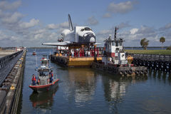 American Space Shuttle. Space shuttle orbiter replica of Explorer travelling on barge through port Canaveral heading to the Space Center in Houston, Texas, U.S.A Stock Photos