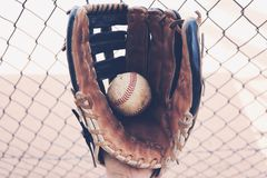 Old rugged  baseball glove in dugout Royalty Free Stock Photos