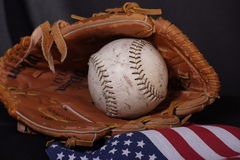 American sport: softball. Baseball & glove with american flag flowing out Stock Image