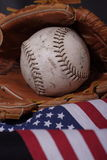 American sport: softball vert. Baseball & glove with american flag flowing out Stock Images