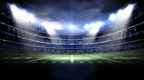 American stadium at night. The imaginary stadium is modelled and rendered Royalty Free Stock Photos