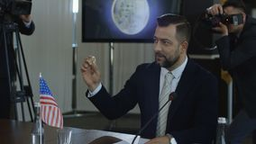 American statesman talking about bitcoin. Bearded formal man of American government sitting on economic summit and speaking about bitcoin cryptocurrency stock video footage