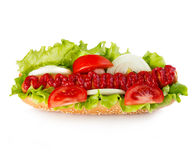 American style hot dog with lettuce, onion and tomato close-up on white background. Fast food. Royalty Free Stock Images