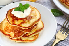 American style pancakes. Close up of plate with a pile of home made pancakes Royalty Free Stock Photo