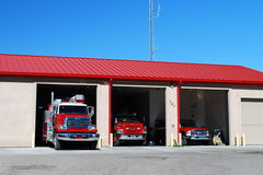 AMERICAN SUBURBAN FIRE STATION. Suburban USA Fire Station with fire trucks Stock Image