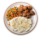 American Supper. An american supper of mashed potatoes, with sweet and sour meatballs with peas and carrots Royalty Free Stock Image