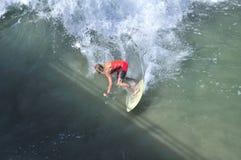 American Surfer on Manhattan Beach California. A surfer riding the waves at manhattan beach california on the west coast Stock Photography
