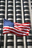American symbol. USA flag with business building  as a backdrop Stock Image