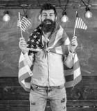 American teacher waves with american flags. Student exchange program. Patriotic education concept. Man with beard and stock images