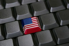 American technology. Computer keyboard with one key colored with American flag Stock Photo