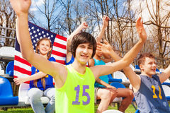 American teenage sport fans watching the game Royalty Free Stock Photos