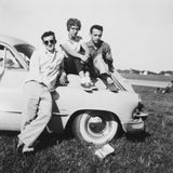 American Teenagers Hanging Out in the Fifties. American teenagers are hanging out with a classic car in the nineteen fifties. The 1950's were an iconic era in Stock Photo