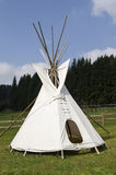 American teepee on the meadow. Native american wigwam on the meadow stock photo