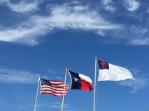 American Texan and Christian. Flags flying over school Royalty Free Stock Photography