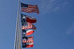 American And Texas Flags I. American and Texas flags on a windy day Stock Images