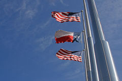 American And Texas Flags II. American and Texas flags on a windy day Royalty Free Stock Photography