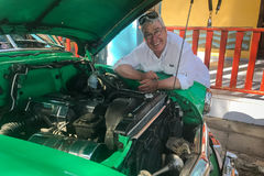American tourist with 1952 Chevrolet engine stock images