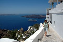 American tourist on the streets of Santorini Royalty Free Stock Images