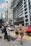 American tourists at a crosswalk in Hong Kong. HONG KONG - SEPTEMBER 30, 2011: American tourists at a crosswalk in Hong Kong. Tourism industry is an important royalty free stock photos