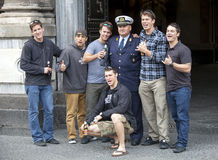 American tourists taking picture with an Italian cop. Catania, Sicily. stock image