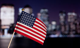 American toy flag over night Down Town Manhattan. Royalty Free Stock Image