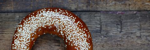 American traditional bagel closeup on a wooden table. royalty free stock photography