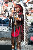 American in traditional costume. An unidentified Amerindian performs in traditional costume during street show at Istiklal Street on July 06, 2010 in Istanbul Stock Images