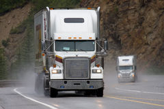 American truck. Two large American trucks on a highway in the rain Royalty Free Stock Images