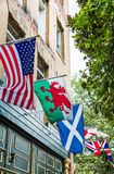 American and United Kingdom Flags on Pub Royalty Free Stock Image