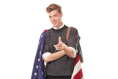 American university student. Portrait of male university student with American flag over his shoulders Royalty Free Stock Image
