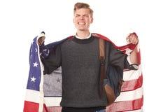 American university student. Portrait of male university student with American flag over his shoulders Stock Photo