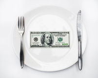 American US dollar on the white plate. Royalty Free Stock Photo