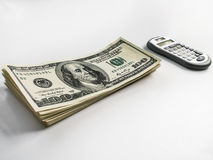 American US dollars and calculator. On a white background Royalty Free Stock Images