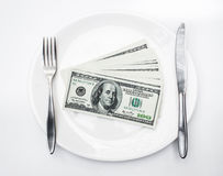 American US dollars on the white plate. Royalty Free Stock Image