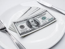 American US dollar on the white plate.  Stock Photography
