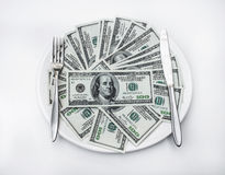 American US dollar on the white plate.  Royalty Free Stock Photos