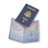American, US passports, isolated. US passport on top of open passport on white with shadow, isolated with clipping path Royalty Free Stock Photos