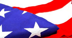 4a4f64fcac7 American USA flag closeup on white background. The flag shows a close up  section of
