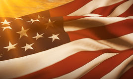 American USA flag, stars and stripes at sunset, with sun rays light Stock Image
