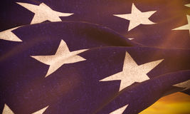 American USA flag, stars at sunset, with sun rays light Stock Image