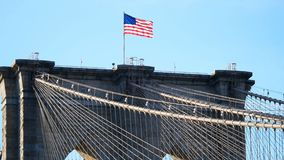 American or usa flag wawing top of Brooklyn bridge new york city. American or usa flag wawing on top of Brooklyn bridge new york city stock video