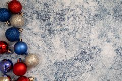 American USA patriotic flatlay Christmas holiday background with ornaments in red white and blue colors. Useful for Christmas in J